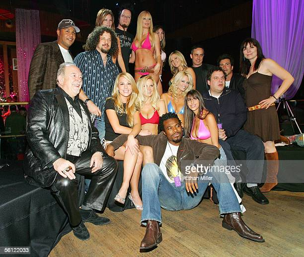 Playboy Cyber Girls models pose with participants in a celebrity strip poker event television host Robin Leach Atlanta Braves center fielder Andruw...