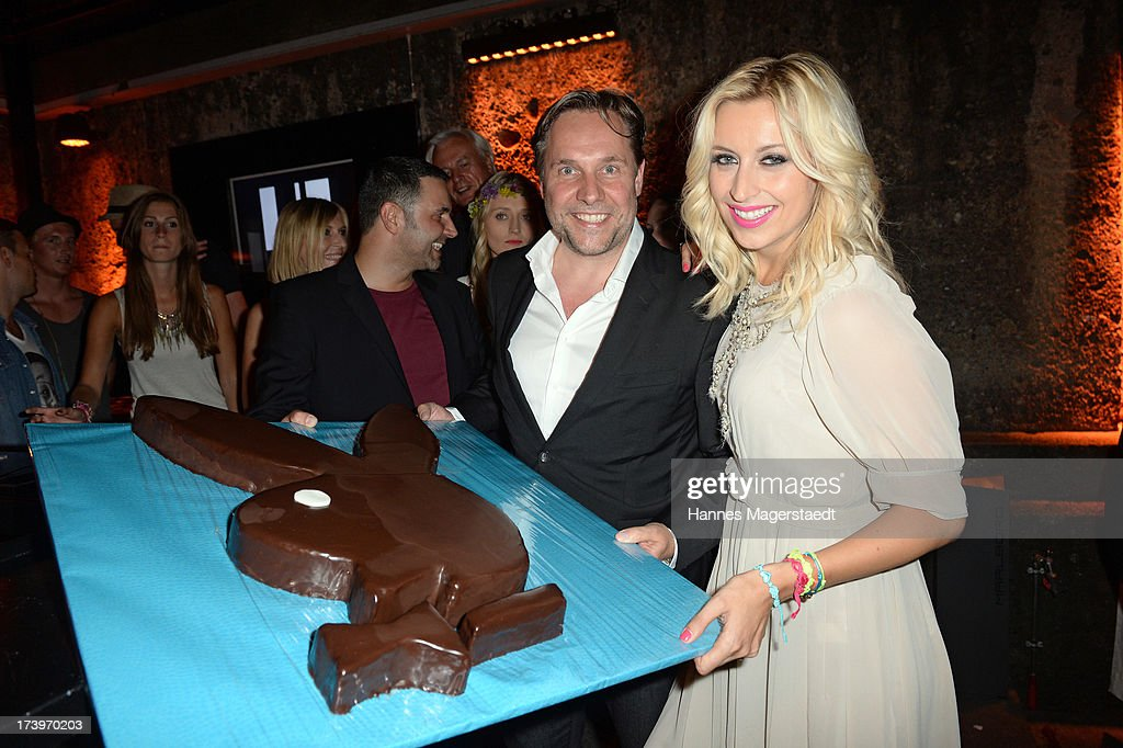 Playboy editor in chief Florian Boitin and Verena Kerth pose with her birthday cake during the Verena Kerth birthday party at P1 on July 18, 2013 in Munich, Germany. Kerth also celebrated the release of the new Playboy issue with her on the cover.