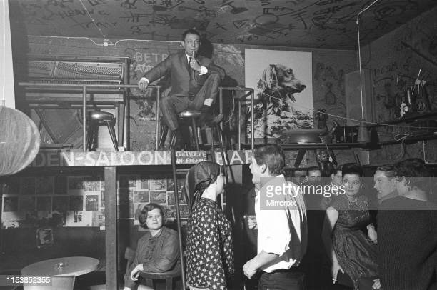 Playboy film maker and night club owner Rolf Eden seen here at the Old Eden Saloon night club Berlin Circa 1965