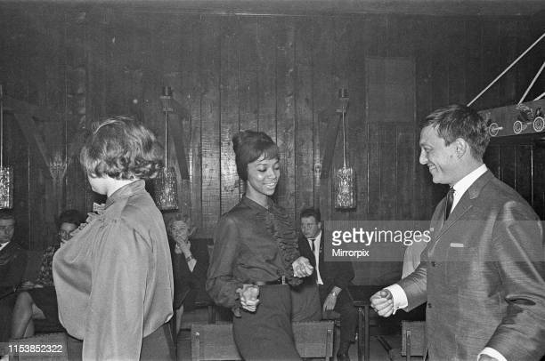 Playboy film maker and night club owner Rolf Eden seen here dancing with one of the patrons of his Old Eden Saloon night club Berlin Circa 1965