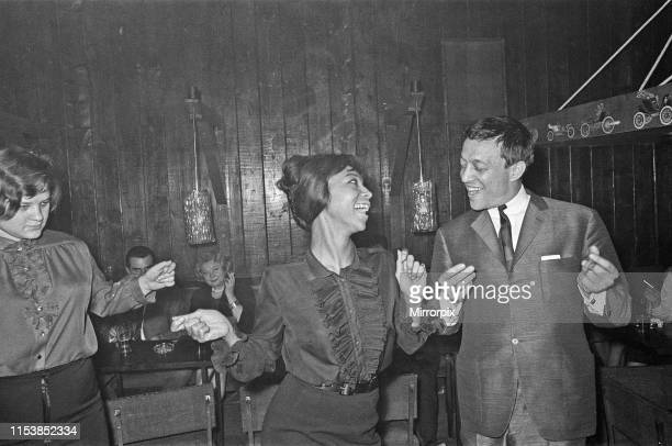 Playboy film maker and night club owner Rolf Eden seen here dancing with one of the patrons of his Old Eden Saloon night club Circa 1965