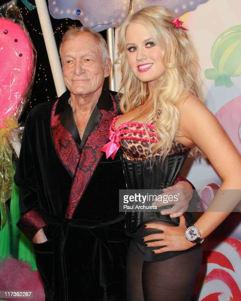 Playboy founder Hugh Hefner and Anna Sophia Berglund arrive at the 6th annual Kandyland event at the Playboy Mansion at The Playboy Mansion on June...