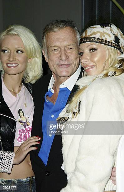 Playboy founder Hugh Hefner and bunnies attend a party in celebration of Recording artist Lil' Kim's cover of Nylon magazine's summer issue at White...