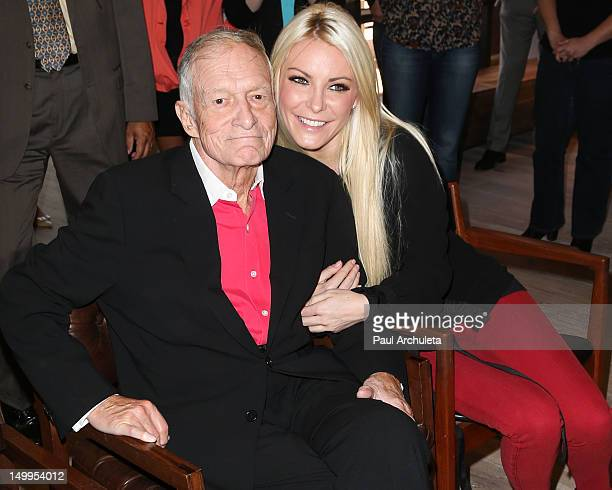 Playboy Founder Hugh Hefner and Playmate Crystal Harris attend The Beverly Hills City Council and Playboy Enterprises Inc ribbon cutting ceremony...