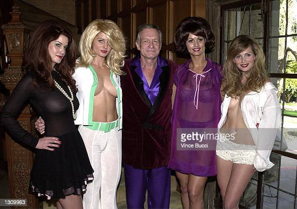 Playboy founder Hugh Hefner center poses with playmates left to right Carrie Stevens Kalin Olson Karen McDougal and Deanna Brooks dressed as pinup...