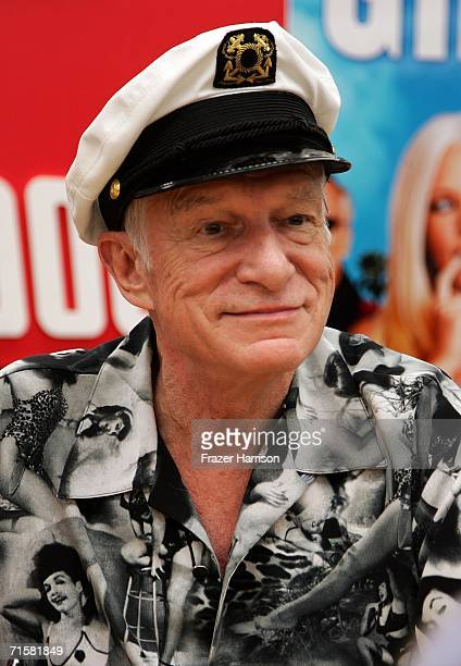 Playboy founder Hugh Hefner poses at the 'The Girls Next Door' DVD signing at Tower Records Sunset August 3 2006 in Los Angeles California