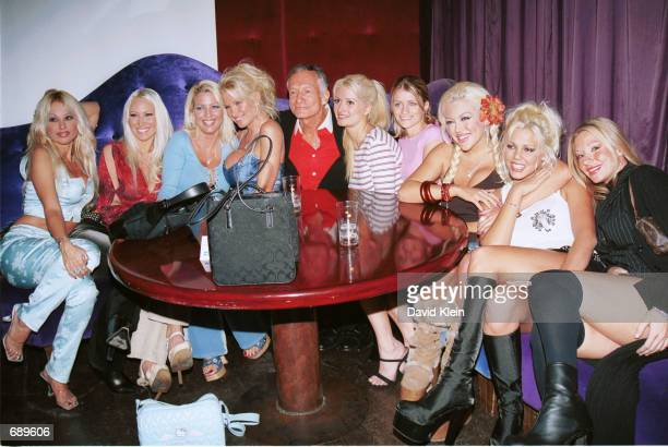 Playboy founder Hugh Hefner poses with his playmates at Barfly club for the Barfly Friday Night Christmas Party featuring Playboy Magazines January...