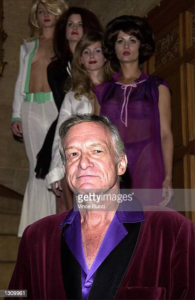 Playboy founder Hugh Hefner poses with playmates left to right Kalin Olson Carrie Stevens Deanna Brooks and Karen McDougal dressed as pinup girls...
