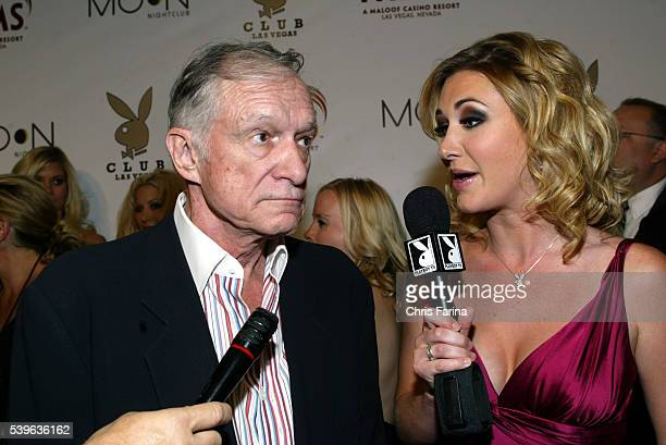 Playboy Founder Hugh Hefner speaking with Playboy TV's Andrea Lowell on his arrival at the the Playboy Club grand opening at the Palms Casino Resort...