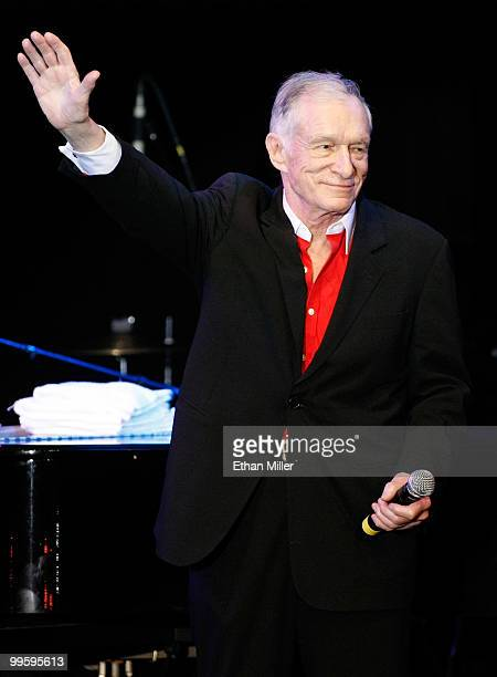 Playboy founder Hugh Hefner waves at a party introducing model Hope Dworaczyk as the 2010 Playboy Playmate of the Year at the Rain Nightclub inside...