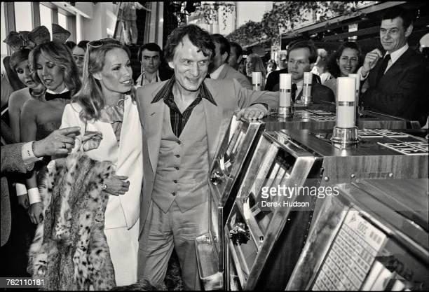 Playboy impresario Hugh Hefner with his girlfriend model Sondra Theodore at the Grand Opening of the Playboy HotelCasino in Atlantic City New Jersey...