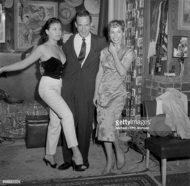 Playboy Magazine founder and publisher Hugh Hefner attends a party in his honor with actress Joan Bradshaw on June 26 1957 in Los Angeles California