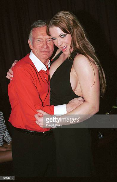 Playboy magazine founder Hugh Hefner and female wrestler Chyna pose for the Barfly Clubs Friday Night Christmas Party featuring the magazines January...