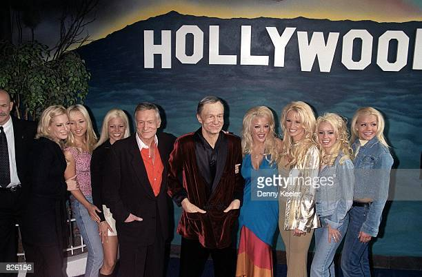 Playboy Magazine founder Hugh M Hefner fourth from the left along with seven of his playmates outside the Hollywood Wax Museum February 20 2001 in...