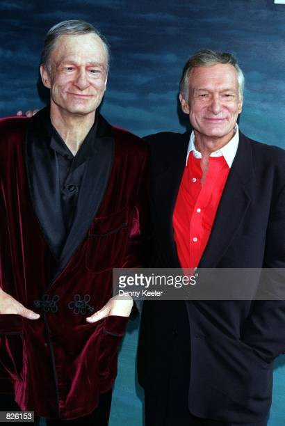 Playboy Magazine founder Hugh M. Hefner, right, stands next to his likeness in wax outside the Hollywood Wax Museum, February 20, 2001 in Hollywood,...