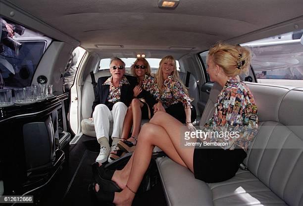 Playboy magazine publisher Hugh Hefner accompanied by his playmates Brande Roderick Sandy and Mandy Bentley | Location Paris