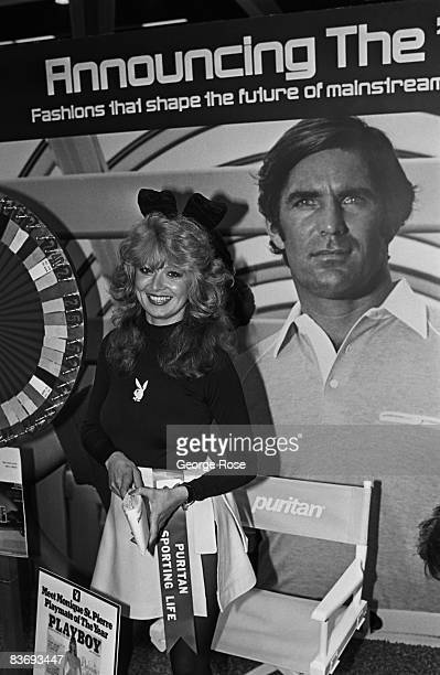 Playboy magazine's 1979 Playmate of the Year Monique St Pierre poses at a promotional booth in this 1980 Los Angeles California photo taken at the LA...