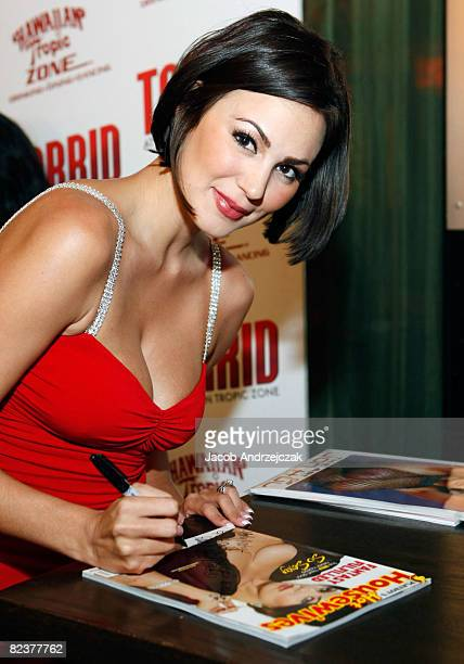 Playboy model Sara Stokes signs her August cover issue Of Playboy's Hot Housewives at Hawaiian Tropic Zone's 'Torrid' Nightclub at the Planet...
