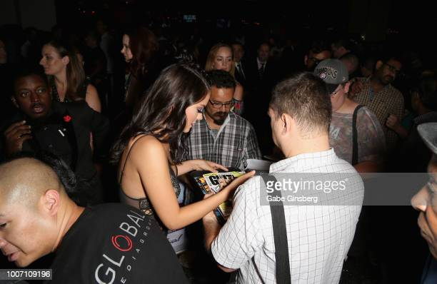 Playboy Playmate Alexandra Tyler signs autographs as she arrives at Playboy's Midsummer Night's Dream at the Marquee Nightclub at The Cosmopolitan of...