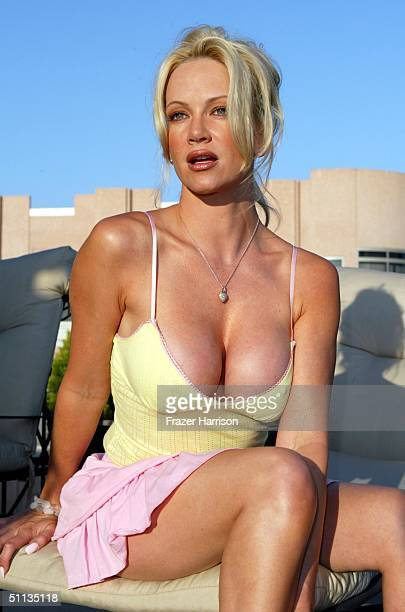 Playboy Playmate Barbara Moore poses in Miken for the Pelle Pelle presents Nicole Richie's Celebrity Catwalk for Charity prefashion show fitting held...