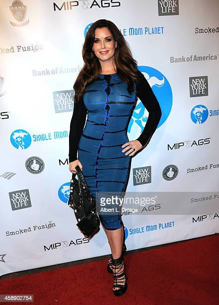 Playboy Playmate Carrie Stevens arrives for the Single Mom Planet Jazz Celebration held at HOME on November 12 2014 in Beverly Hills California