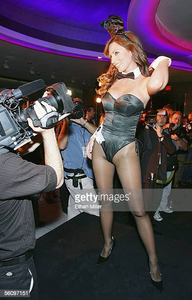 Playboy Playmate Deanna Brooks wears a vintage Playboy Bunny costume during a fashion show to introduce new Playboy Bunny costumes designed by...