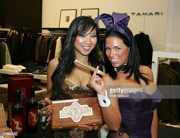 Playboy Playmate Janine Habeck and another model pose together at the launch of City Nights Playboy Menswear Collection at Bloomingdales on October...