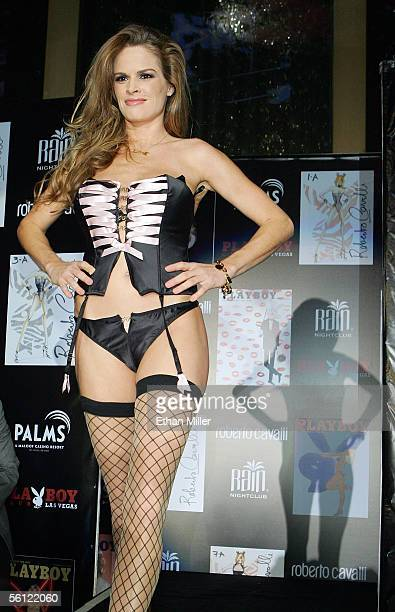 Playboy Playmate Julie Cialini presents a Playboy outfit during a fashion show to introduce new Playboy Bunny costumes designed by Roberto Cavalli...