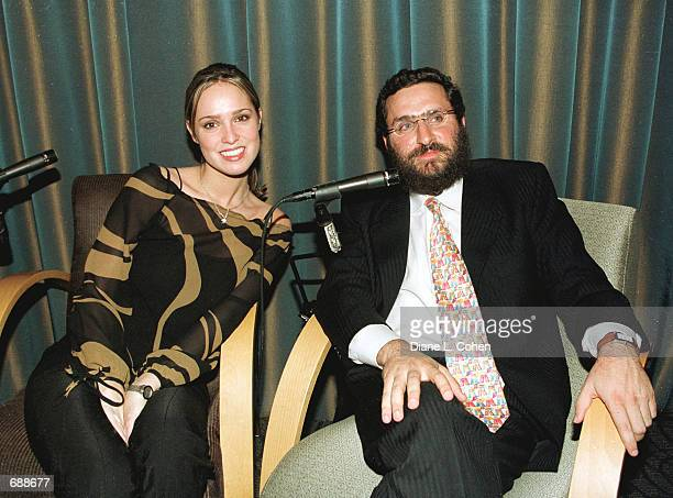 Playboy Playmate Lindsey Vuolo and Rabbi Shmuley Boteach pose for the photographers after a debate on pornography December 19 2001 at the Makor...