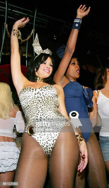 Playboy Playmate of the Year 2005 Tiffany Fallon and Playmate Qiana Chase wave to the crowd after modeling outfits during a fashion show to introduce...