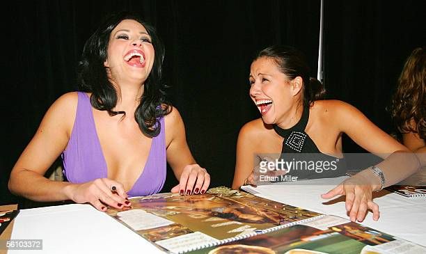 Playboy Playmate of the Year 2005 Tiffany Fallon and Playmate Pennelope Jimenez share a laugh as they sign their photos in Playboy's 2006 Playmates...