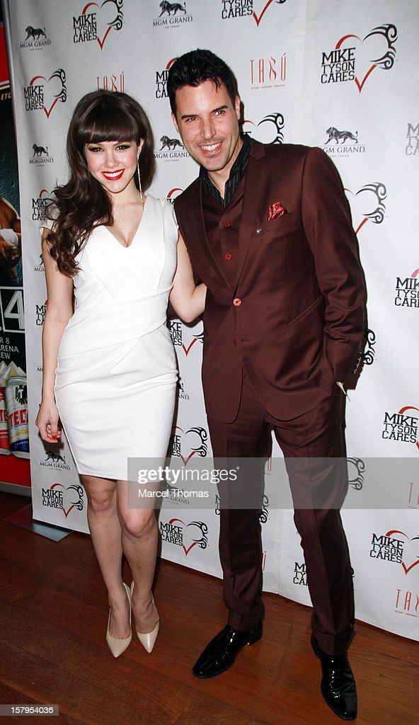 Playboy Playmate of the Year Claire Sinclair and Las Vegas headline Frankie Moreno attend the Launch Party for 'Mike Tyson Cares Foundation' at Tabu Ultra Lounge at MGM Grand on December 7, 2012 in Las Vegas, Nevada.