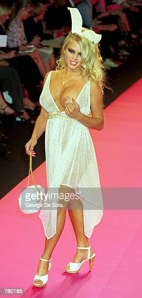 Playboy Playmate presents the latest in women's fashion at the Betsey Johnson '7th On Sixth' Spring 2001 fashion show September 19 2000 in New York...