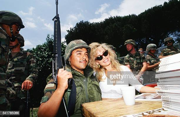 Playboy Playmate Suzi Simpson signs autographs for National Guard soldiers posted near the Coliseum in Los Angeles. Los Angeles has undergone several...