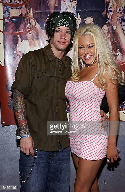 Playboy Playmate Tiffany Holliday and DJ Ashba arrive at the record release party for Gene Simmons' 'Asshole' on April 22 2004 at the Key Club in...
