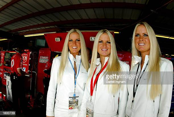 Playboy Playmate triplets Erica Jaclyn and Nicole Dahm visit the Target Ganassi Racing Dodge Intrepid garage during practice for the NASCAR Winston...