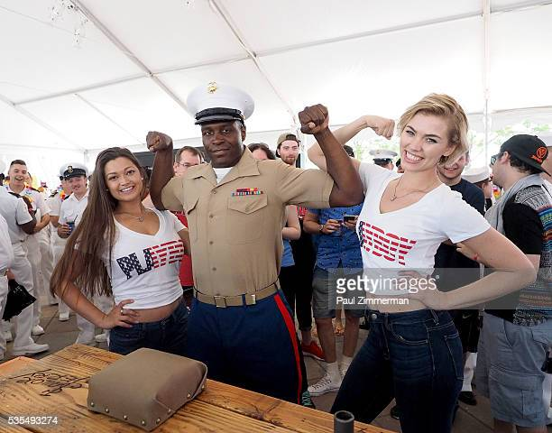 Playboy playmates Chelsie Aryn and Britt Linn attend the Sailor Jerry Fleet Week Block Party 2016 at Pier 84 on May 29 2016 in New York City