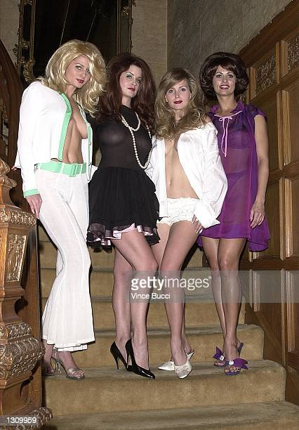 Playboy playmates left to right Kalin Olson Carrie Stevens Deanna Brooks and Karen McDougal dressed as pinup girls pose for photos December 7 2000 at...