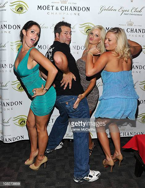 Playboy Playmates Lindsey Vuolo Lauren Anderson and Laurie Fetter with Joey Fatone attend the grand opening of Golden Eyes on August 5 2010 in St...