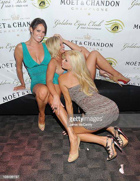 Playboy Playmates Lindsey VuoloLaurie Fetter and Lauren Anderson attend the grand opening of Golden Eyes on August 5 2010 in St Maarten Netherlands...