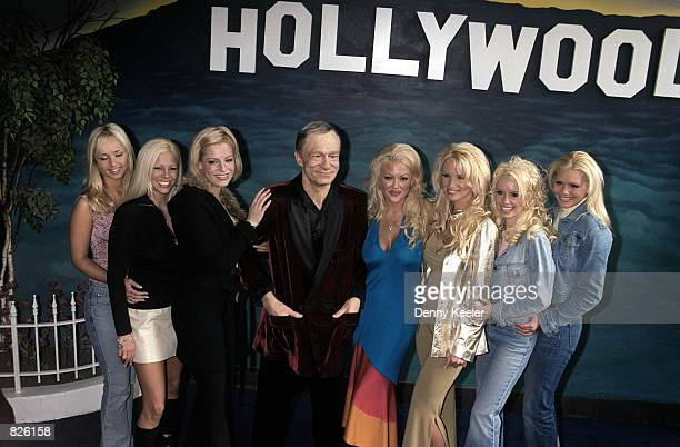 Playboy playmates stand next to a Hugh M Hefner likeness in wax outside the Hollywood Wax Museum February 20 2001 in Hollywood CA The event was in...
