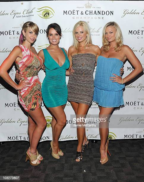 Playboy Playmates Tyren Richard Lindsey Vuolo Lauren Anderson and Laurie Fetter attend the grand opening of Golden Eyes on August 5 2010 in St...