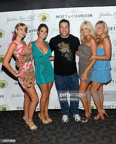 Playboy Playmates Tyren Richard Lindsey Vuolo Lauren Anderson and Laurie Fetter with Joey Fatone attend the grand opening of Golden Eyes on August 5...