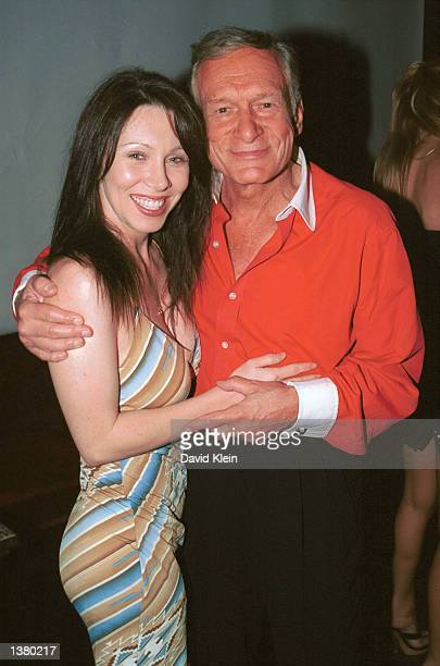 Playboy Publisher Hugh Hefner and actress GinaRaye Carter attend Corey Feldman's record release party at the Barfly on August 24 2002 in West...