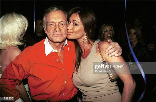 Playboy publisher Hugh Hefner and former Playboy playmate Ava Fabian arrive at Hefner's 77th birthday party at Barfly March 30, 2003 in West...