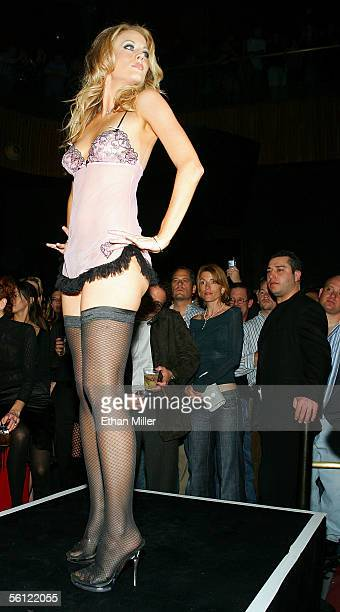 Playboy Shallan Meiers presents a Playboy outfit during a fashion show to introduce new Playboy Bunny costumes designed by Roberto Cavalli during a...