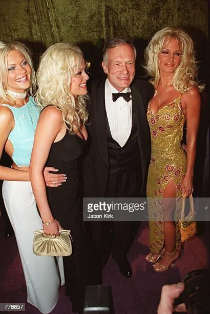 Playboy's founder Hugh Hefner with a trio of blond babes Buffy Tyler Katie Lohmann and Tina Giordano at HBO's Emmy party at Spago September 10 2000...