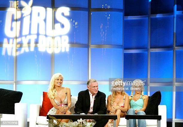Playboy's Hugh Hefner and his Playmates Kendra Wilkinson Bridget Marquardt and Holly Madison attend the panel discussion for The Girls Next Door...