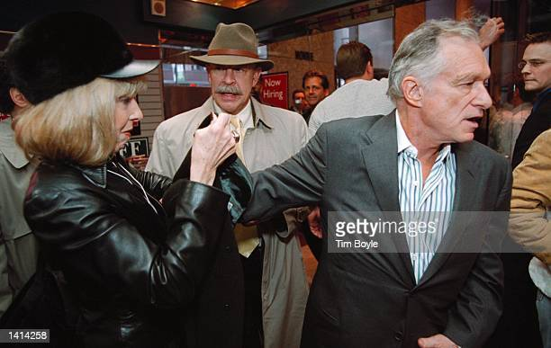 Playboy''s Hugh Hefner right races through a crowd at the Crown Books store in Chicago Il April 11 2000 Hefner was in town with his twin playmate...