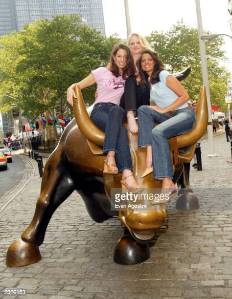 Playboy's Women of Enron pose on the Wall Street Bull in the financial district LR Cynthia Coghlan Christine Nielsen and Carey Lorenzo New York City...